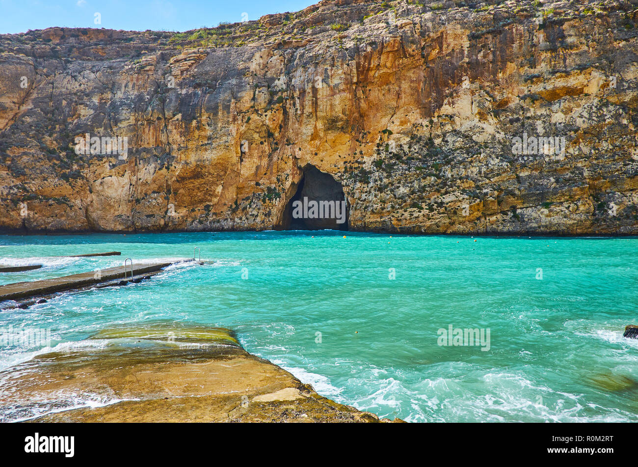 Enjoy the picturesque beach of Dwejra Inland sea with a view on the Blue Hole - the grotto, connecting this place with main Mediterranean waters, San  - Stock Image