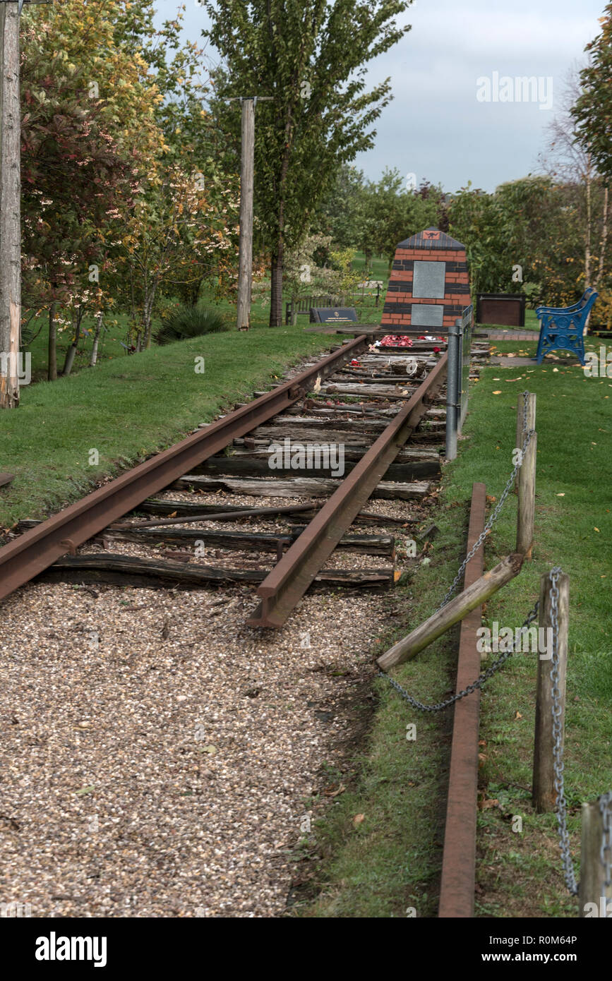 A short rail track as part of a World War 11 memorial to allied prisoners of war, who died whilst working in harsh conditions on the Sumatra railway u - Stock Image