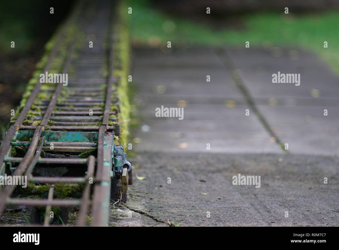 A small train track, padlock and patio area at Tintern Abbey - Stock Image