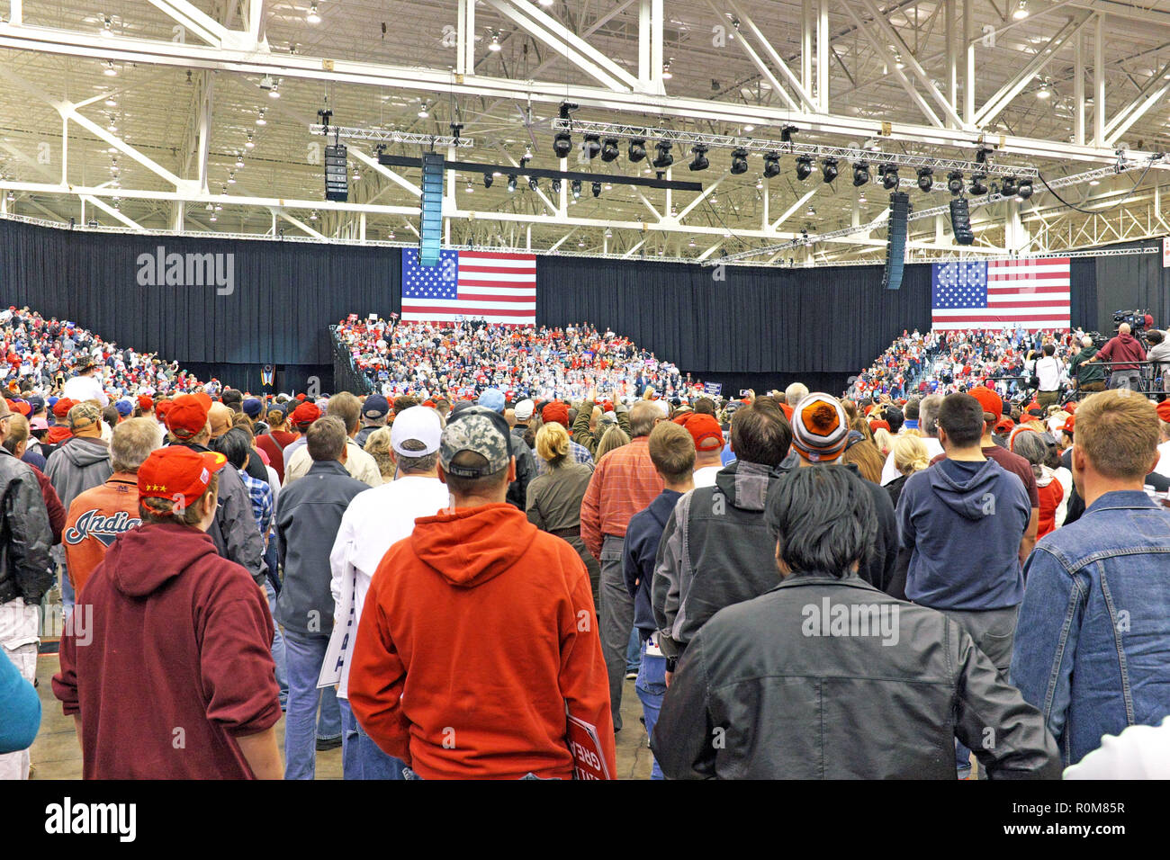 Cleveland, Ohio, USA, 5th Nov, 2018.  Trump supporters fill the Cleveland International Exposition Center in Cleveland, Ohio, USA for a Make America Great Again (MAGA) rally.  Stands are filled and standing room only supporters are there to support the President and the President is there to energize his base to go out and vote during the midterm election.  Credit: Mark Kanning/Alamy Live News. - Stock Image