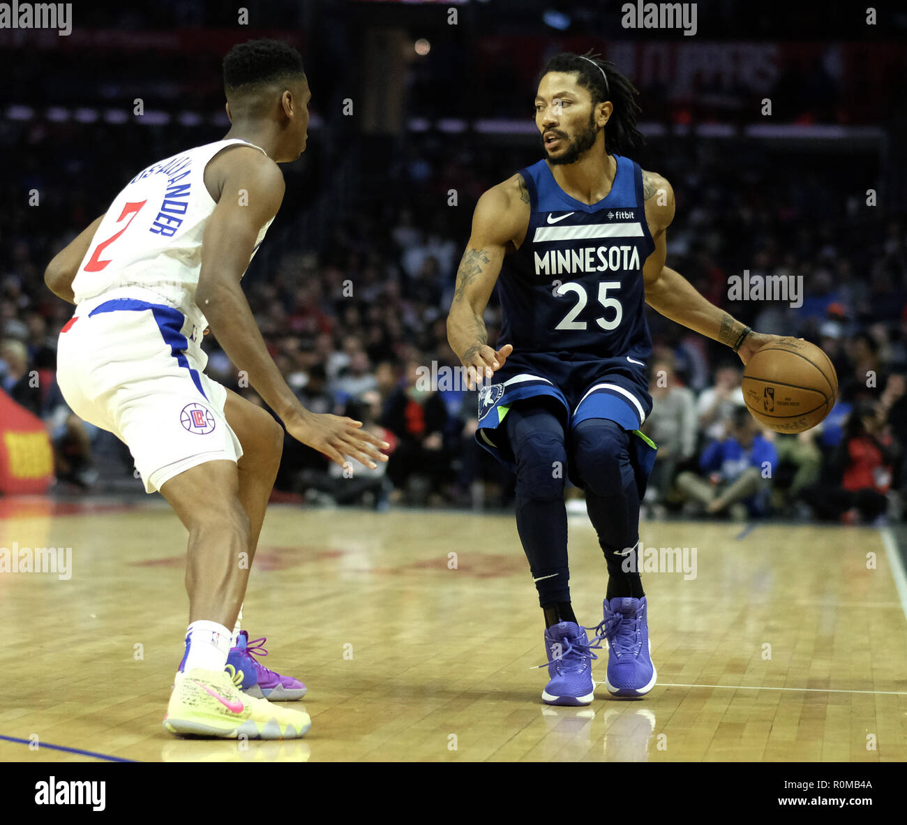 e21cd2590a8c Minnesota Timberwolves  Derrick Rose (25) dribbles against Los Angeles  Clippers  Shai Gilgeous-Alexander (2) during an NBA basketball game Monday