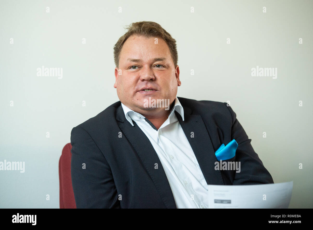 Berlin, Germany. 06th Nov, 2018. Franz Kerker (AfD), member of the Berlin House of Representatives, speaks to journalists in the parliamentary group rooms of the party about the interim status of the AfD Internet portal 'Neutrale Schule'. On 22.10. the Berlin AfD had put a website online, on which pupils and parents can tell if teachers in class are critical of the AfD. Credit: Arne Immanuel Bänsch/dpa/Alamy Live News - Stock Image