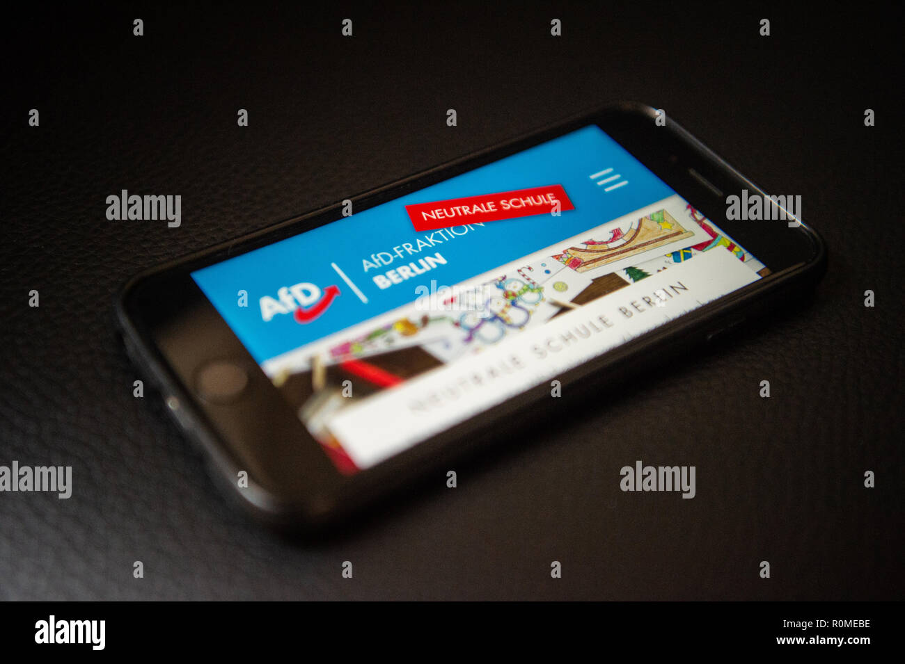 Berlin, Germany. 06th Nov, 2018. ILLUSTRATION - A mobile phone shows the Internet portal neutral school of the citizens of Berlin AfD. On 22.10. the Berlin AfD had put a website online, on which pupils and parents can tell if teachers in class are critical of the AfD. Credit: Arne Immanuel Bänsch/dpa/Alamy Live News - Stock Image