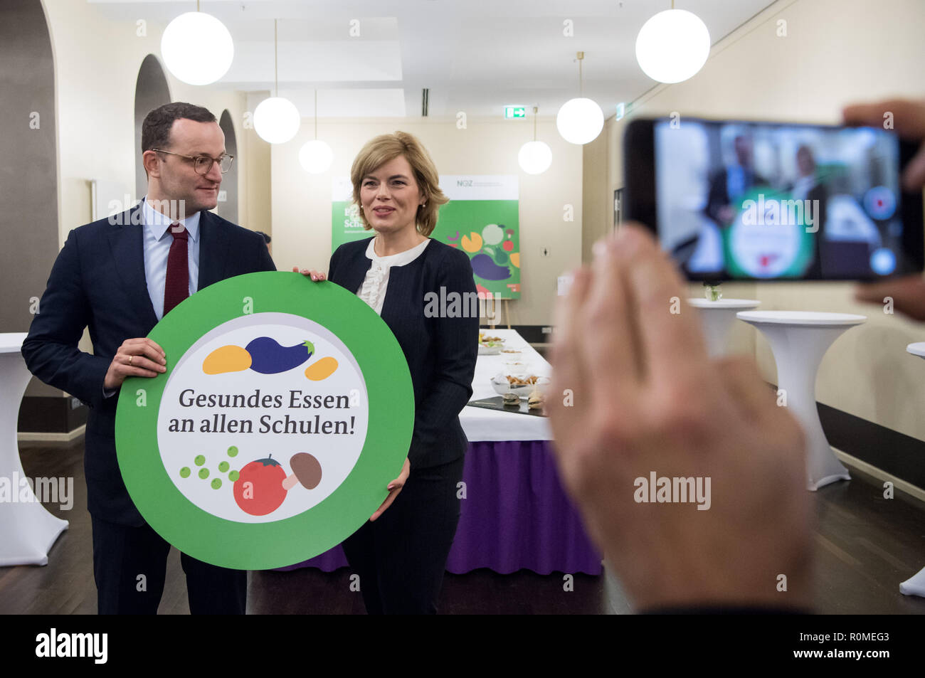 Berlin, Germany. 06th Nov, 2018. Jens Spahn (l, CDU), Federal Minister of Health, and Julia Klöckner (CDU), Federal Minister of Food and Agriculture, hold a sign with the inscription 'Healthy Food at all Schools' at the Federal Congress School Catering. More than three million pupils at all-day schools eat lunch every day at school. Credit: Bernd von Jutrczenka/dpa/Alamy Live News - Stock Image