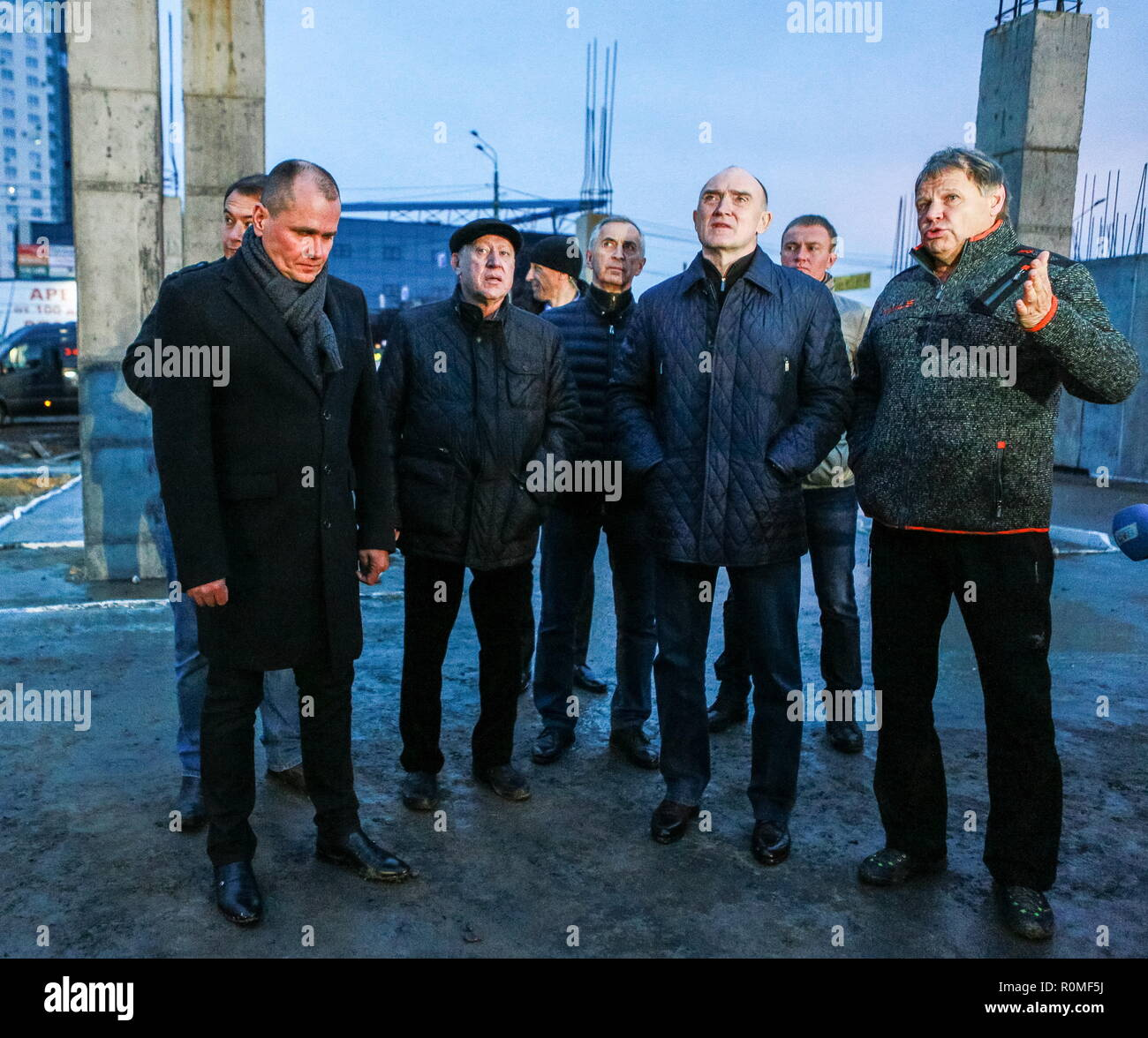 Chelyabinsk, Russia. 04th Nov, 2018. CHELYABINSK, RUSSIA - NOVEMBER 4, 2018: The Mayor of Chelyabinsk Yevgeny Teftelev (2nd L), and the Governor of Chelyabinsk Region Boris Dubrovsky (2nd R front), visit the construction site of the Taganai 2020 Congress Hall at Ulitsa Truda Street; in 2020, Chelyabinsk is going to host an SCO summit and a BRICS summit. Nail Fattakhov/TASS Credit: ITAR-TASS News Agency/Alamy Live News - Stock Image