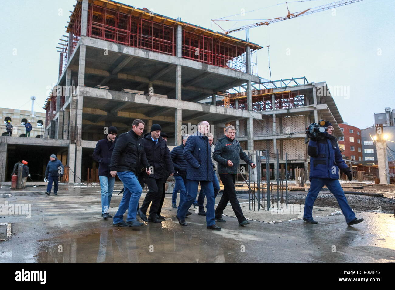 Chelyabinsk, Russia. 04th Nov, 2018. CHELYABINSK, RUSSIA - NOVEMBER 4, 2018: The Governor of Chelyabinsk Region Boris Dubrovsky (C) visits the construction site of the Taganai 2020 Congress Hall at Ulitsa Truda Street; in 2020, Chelyabinsk is going to host an SCO summit and a BRICS summit. Nail Fattakhov/TASS Credit: ITAR-TASS News Agency/Alamy Live News - Stock Image