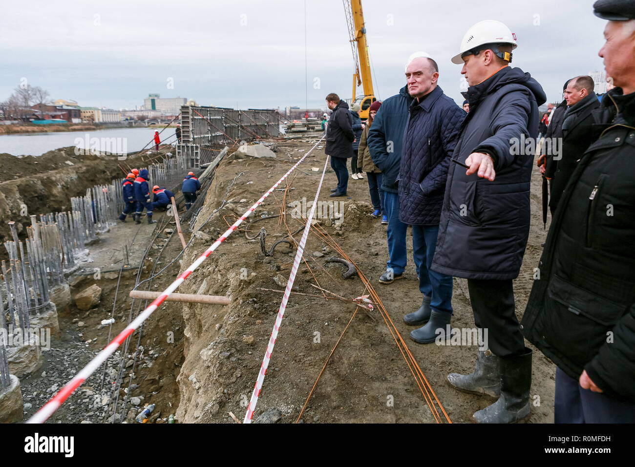 Chelyabinsk, Russia. 04th Nov, 2018. CHELYABINSK, RUSSIA - NOVEMBER 4, 2018: The Governor of Chelyabinsk Region, Boris Dubrovsky (3rd R front), at the construction site of a cultural and business centre by the Miass River; in 2020, Chelyabinsk is going to host an SCO summit and a BRICS summit. Nail Fattakhov/TASS Credit: ITAR-TASS News Agency/Alamy Live News - Stock Image