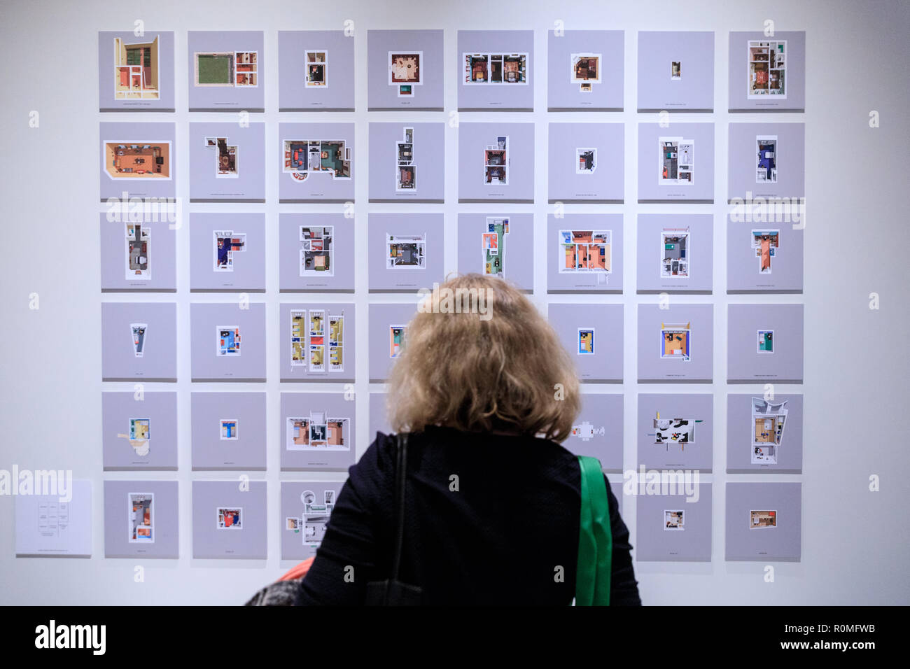 The Design Museum, London, UK, 6th Nov 2018. A visitor looks at the 'Loveless - The Architecture of Minimum Dwelling' exhibit. Bringing together avant-garde speculations with contemporary objects and new commissions, Home Futures explores today's home through the prism of yesterday's imagination. The exhibition will run from 7 Nov 2018 to 24 Mar 2019. Credit: Imageplotter News and Sports/Alamy Live News - Stock Image