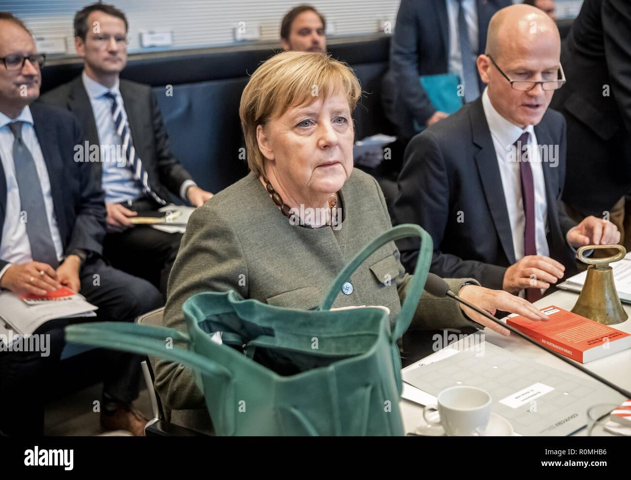 Berlin, Germany. 06th Nov, 2018. Chancellor Angela Merkel (CDU) is waiting next to Ralph Brinkhaus (CDU, r), leader of the CDU/CSU parliamentary group in the Bundestag, for the start of the parliamentary group meeting. Credit: Michael Kappeler/dpa/Alamy Live News - Stock Image