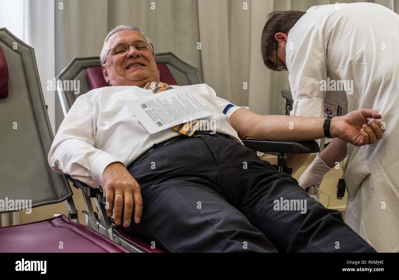 Munich, Bavaria, Germany. 6th Nov, 2018. Bavarian Innenminister JOACHIM HERRMANN and Innenstaatssekretaer GERHARD ECK donated blood today at the Bavarian Innenministerium as part of a blood drive action to receive more blood donations in Bavaria. Over 2,000 donations of blood are required per day to handle the needs of Bavaria, largely for cancer patients, those with internal diseases and pathologies, and those with accident trauma. Credit: Sachelle Babbar/ZUMA Wire/Alamy Live News - Stock Image