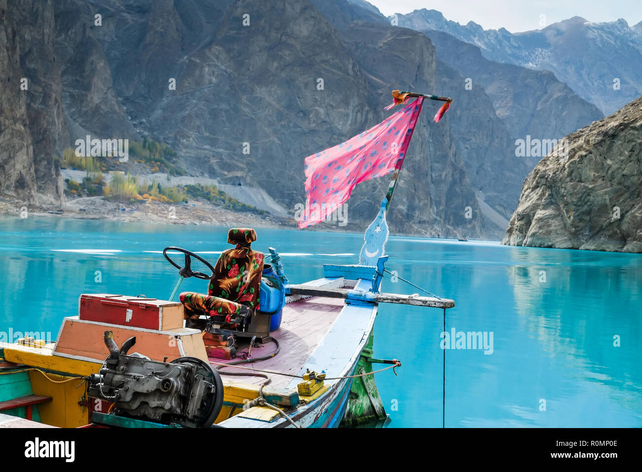 A colorful boat at Attabad lake. Hunza valley, Gilgit Baltistan, Pakistan. - Stock Image