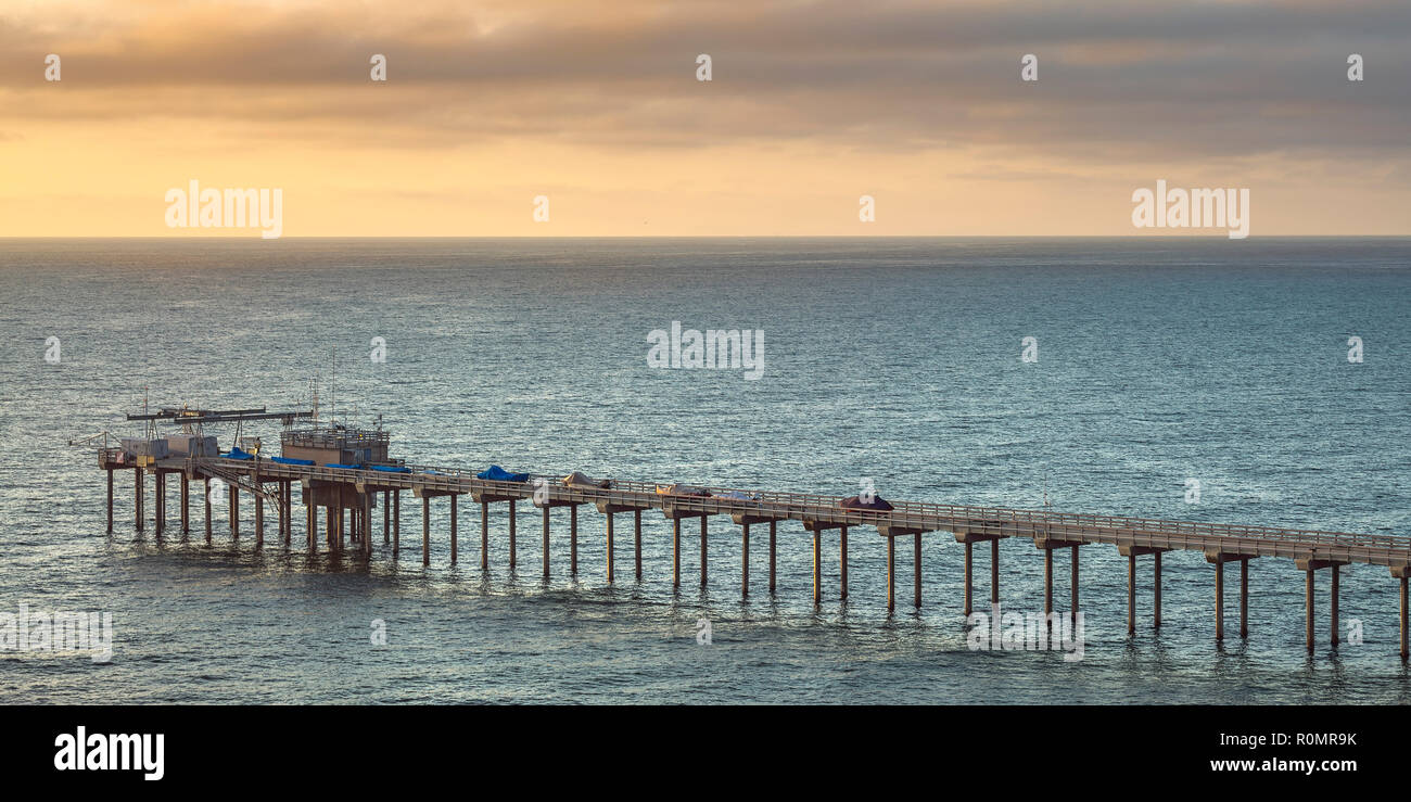 Scripps Pier and horizon at sunset in San Diego - Stock Image