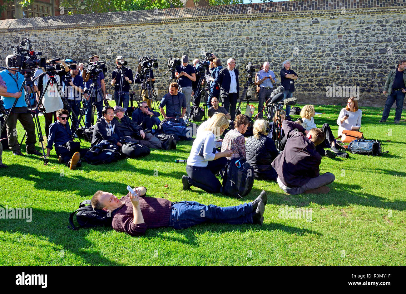 The Media waiting patiently on College Green, Westminster for a delayed press conference. London, England, UK. Stock Photo