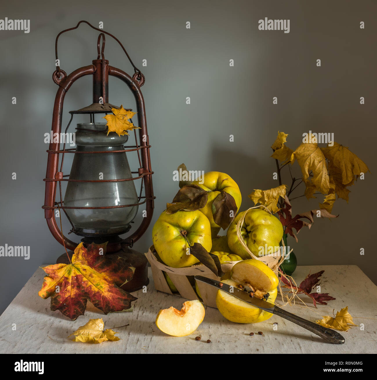 still life with quince and kerosene lamp. kitchen. vintage retro. - Stock Image