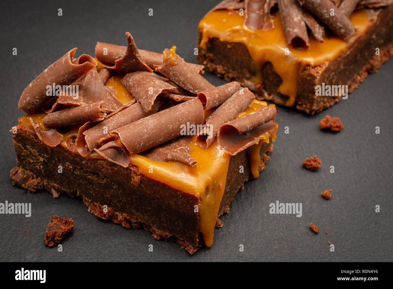 Chocolate Brownies with salted caramel sauce and chocolate flakes Stock Photo