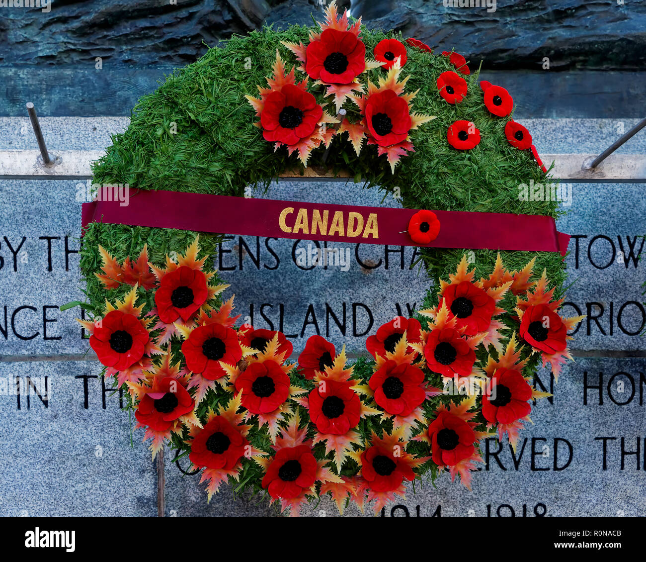 CHARLOTTETOWN, PE, CANADA - DEC. 8, 2017: A Remembrance Day wreath covered in poppies hanging on a Canadian war memorial. - Stock Image