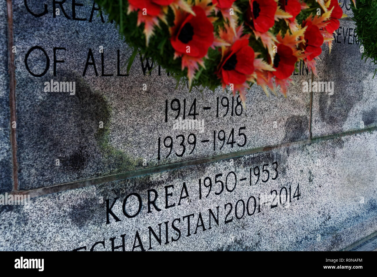 CHARLOTTETOWN, PE, CANADA - DEC. 8, 2017: Inscription on a Canadian War Memorial. - Stock Image
