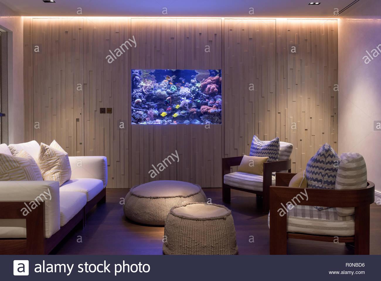 Aquarium in coastal living room - Stock Image