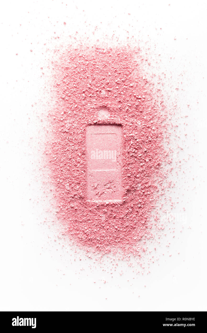 Imprint of perfume bottle on pink face powder. Isolated on a white background. - Stock Image
