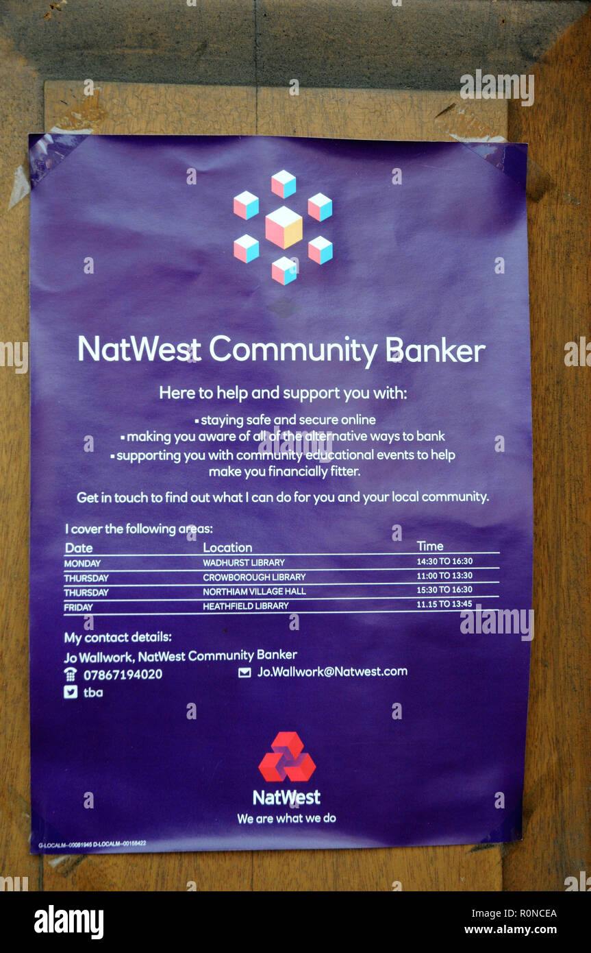 A sign on the door of the Heathfield, East Sussex, branch of Natwest informing customers of the Community Banker services after the branch's closure. - Stock Image