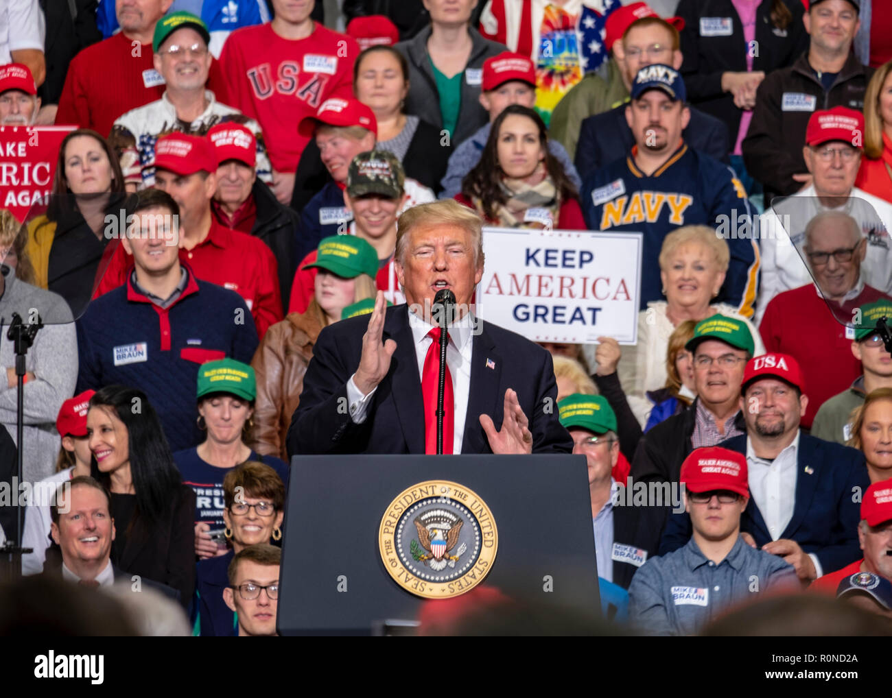 U.S President Donald Trump, addresses a rally of supporters on the eve of mid-term elections at Southport High School November 2, 2018 in Southport, Indiana. - Stock Image