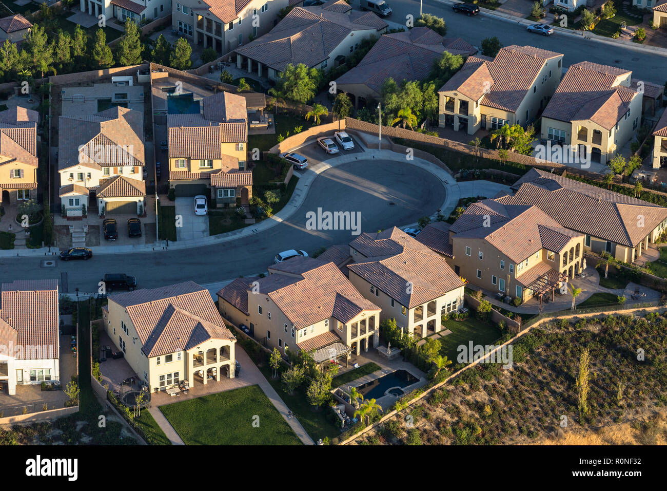 Aerial late afternoon view of suburban cul de sac street in the San Fernando Valley area of Los Angeles, California. Stock Photo