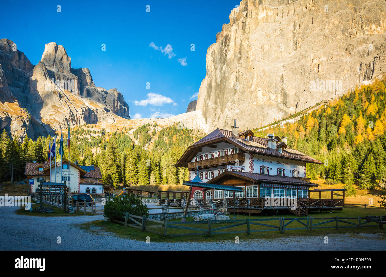 Refuge Monti Pallidi. The refuge was built before construction of the great Dolomites road, at the foot of Piz Ciavazes and Sass Pordoi at Pian Schiav Stock Photo