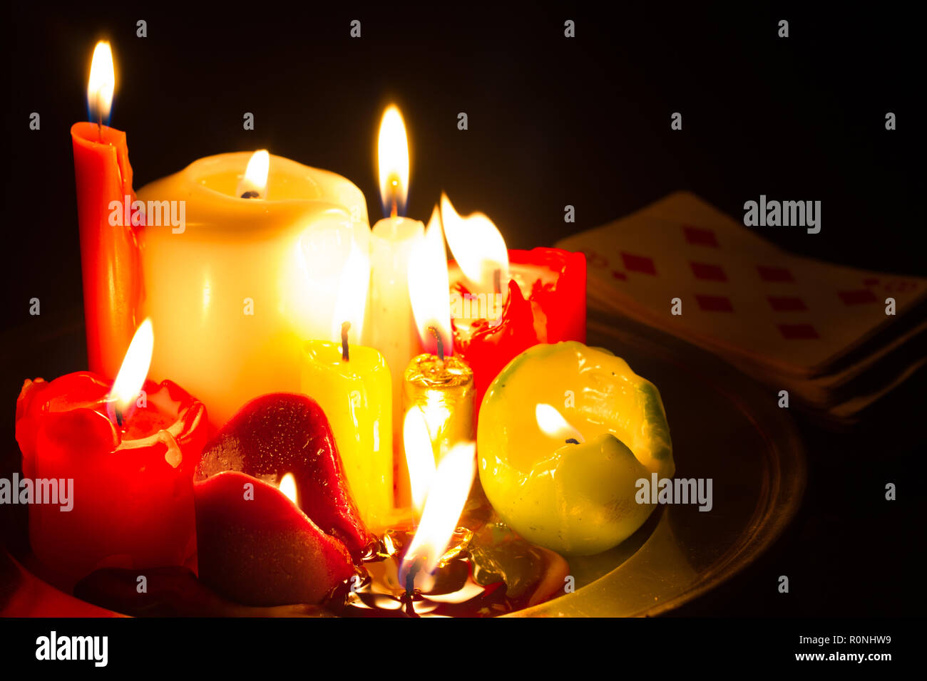 Spells omens and magic abstract background with candles in night - Stock Image