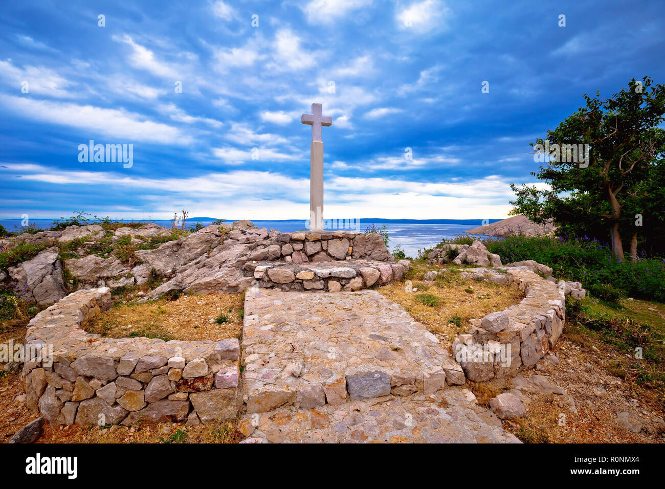 Island of Krk cross by the sea in Stara Baska village, northern Adriatic region of Croatia - Stock Image