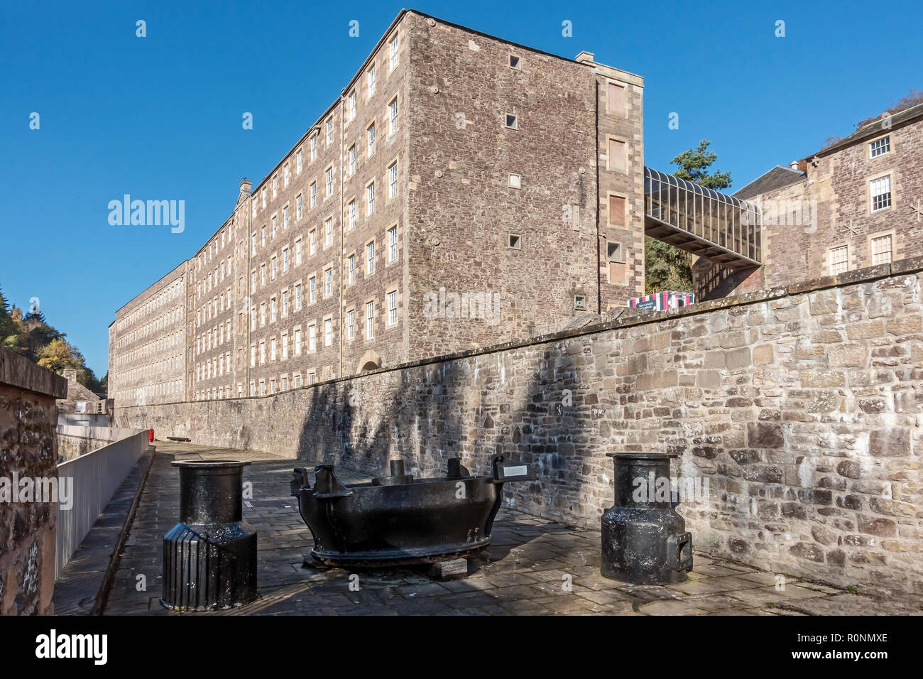 View of Mills 3  & 2 & water turbine remnant at New Lanark Mills World Heritage Site by the River Clyde in Lanark Lanarkshire Scotland UK - Stock Image