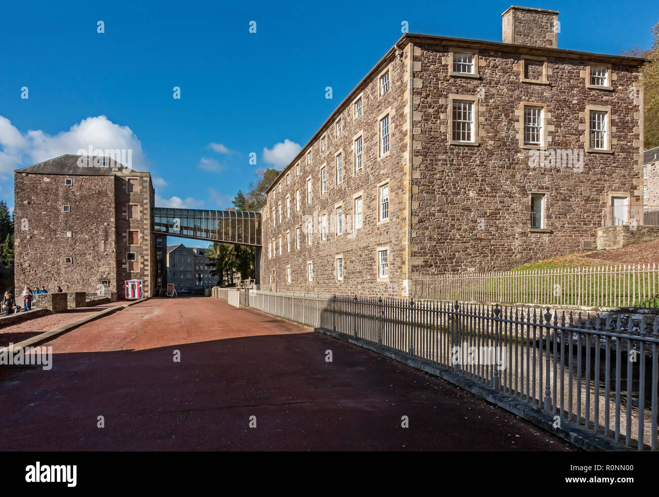 Mill 3 (left) & Institute (right) at New Lanark Mills World Heritage Site by the River Clyde in Lanark Lanarkshire Scotland UK - Stock Image