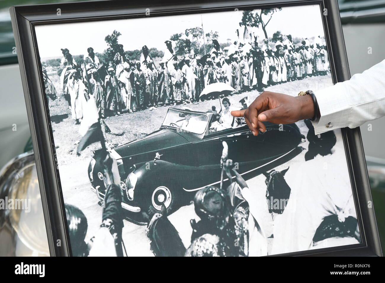 A framed photograph of Queen Elizabeth II driving a car when she