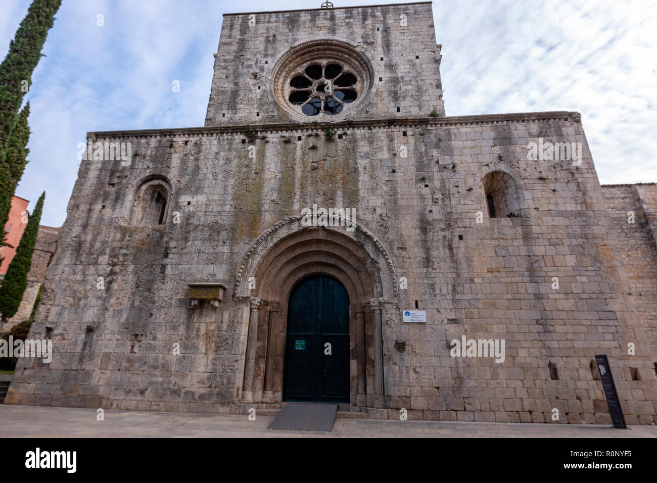 Facade with the Rosette and archaic cover of Sant Pere de Galligants, Romanesque church, Benedictine abbey , Girona, Catalonia, Spain - Stock Image
