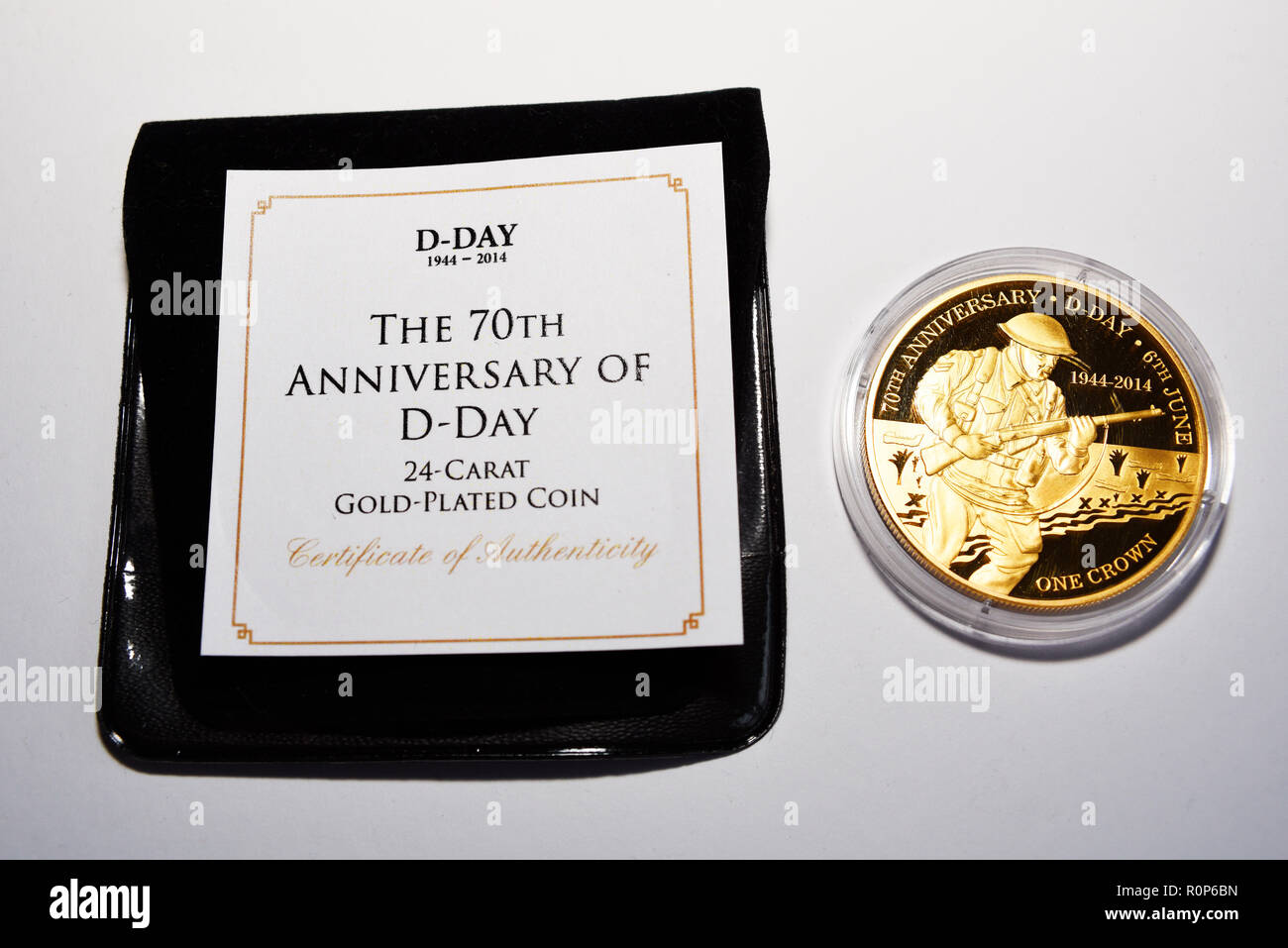 Specially minted coin. 70th anniversary D-Day 24 carat gold plated one crown coin. Commemoration coin. Second World War remembered. White background - Stock Image