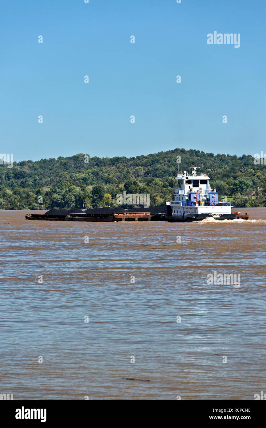 Tugboat pushing loaded coal barges upriver,  Ohio River. - Stock Image