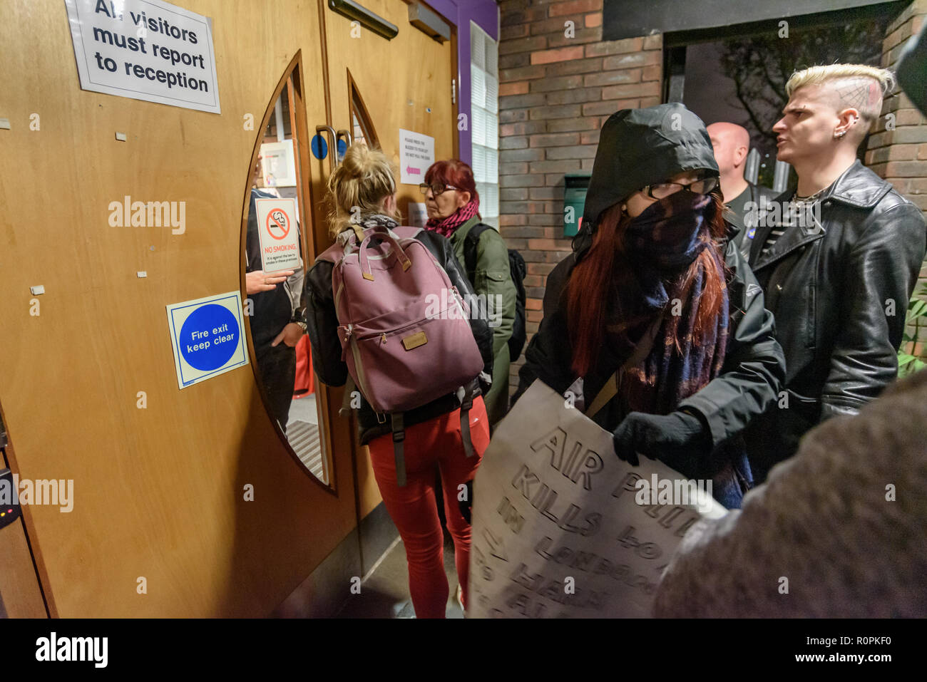 London, UK. 6th November 2018. Campaigners trying to stop Lewisham Council and developer Peabody from demolishing Reginald House and building on the community Old Tidemill Wildlife Garden  try to attend the New Cross Assembly Meeting where Lewisham Mayor and local councillors were expected to take questions from the public. . Some protesters had gone inside the meeting earlier, but others wanted to go in for the Mayor's question time but were not admitted by the time I left, 15 minutes after it had been scheduled to start and it was not clear if the Mayor intended coming. Credit: Peter Marshal - Stock Image