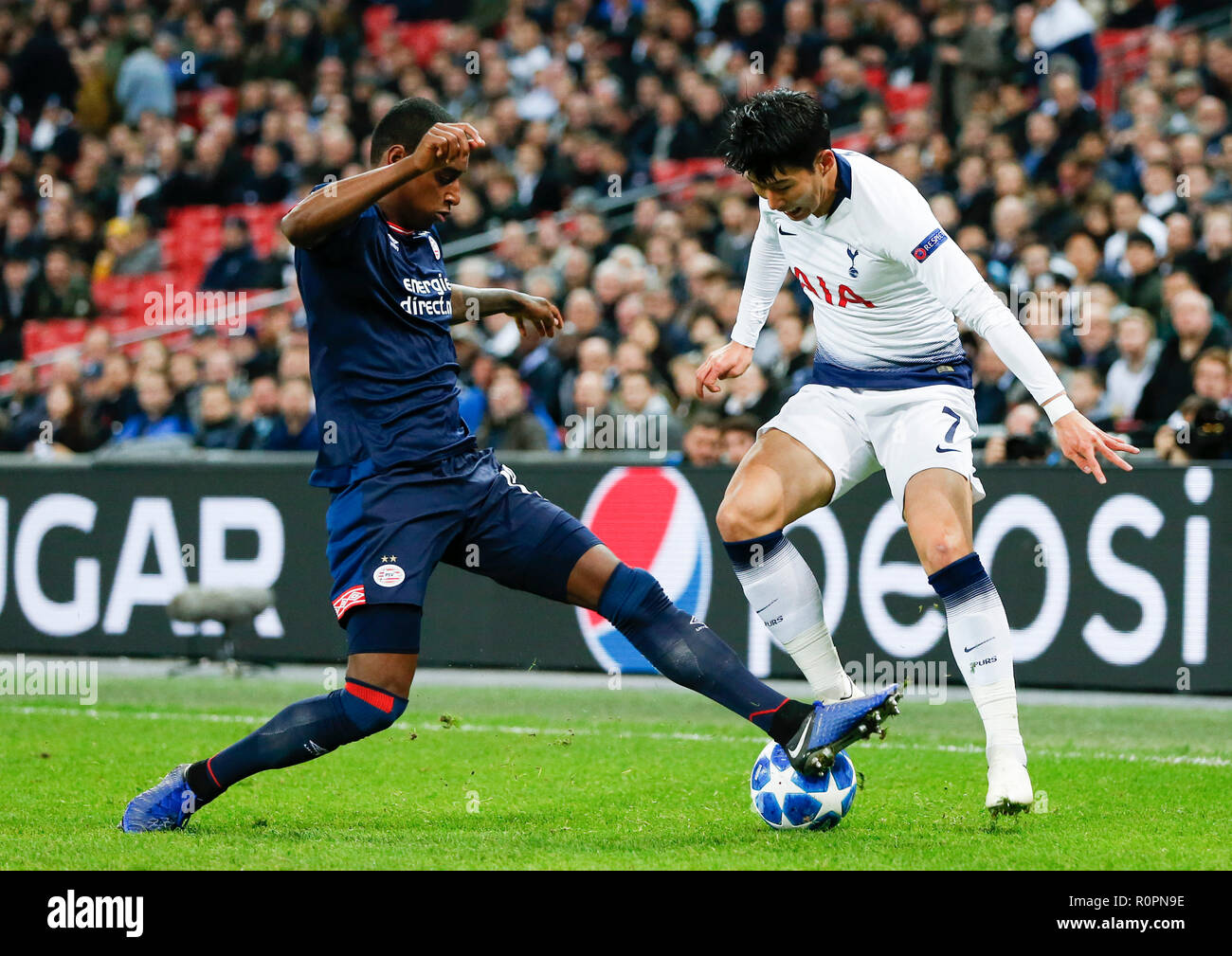 17c0c8ab01f Tottenham Hotspur s Son Heung-Min (R) competes during the UEFA Champions  League match between Tottenham Hotspur and PSV Eindhoven in London