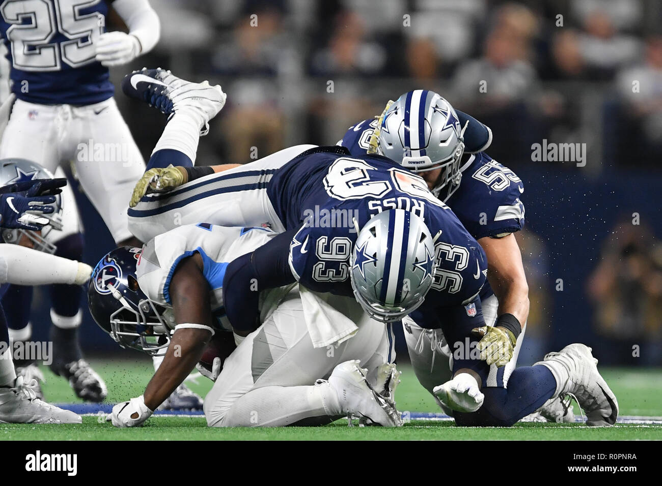 Arlington, Texas, USA. 5th Nov, 2018. Dallas Cowboys linebacker Leighton Vander Esch (55) and Dallas Cowboys defensive tackle Daniel Ross (93) tackles Tennessee Titans running back Dion Lewis (33) during the NFL football game between the Tennessee Titans and the Dallas Cowboys at AT&T Stadium in Arlington, Texas. Shane Roper/Cal Sport Media/Alamy Live News - Stock Image