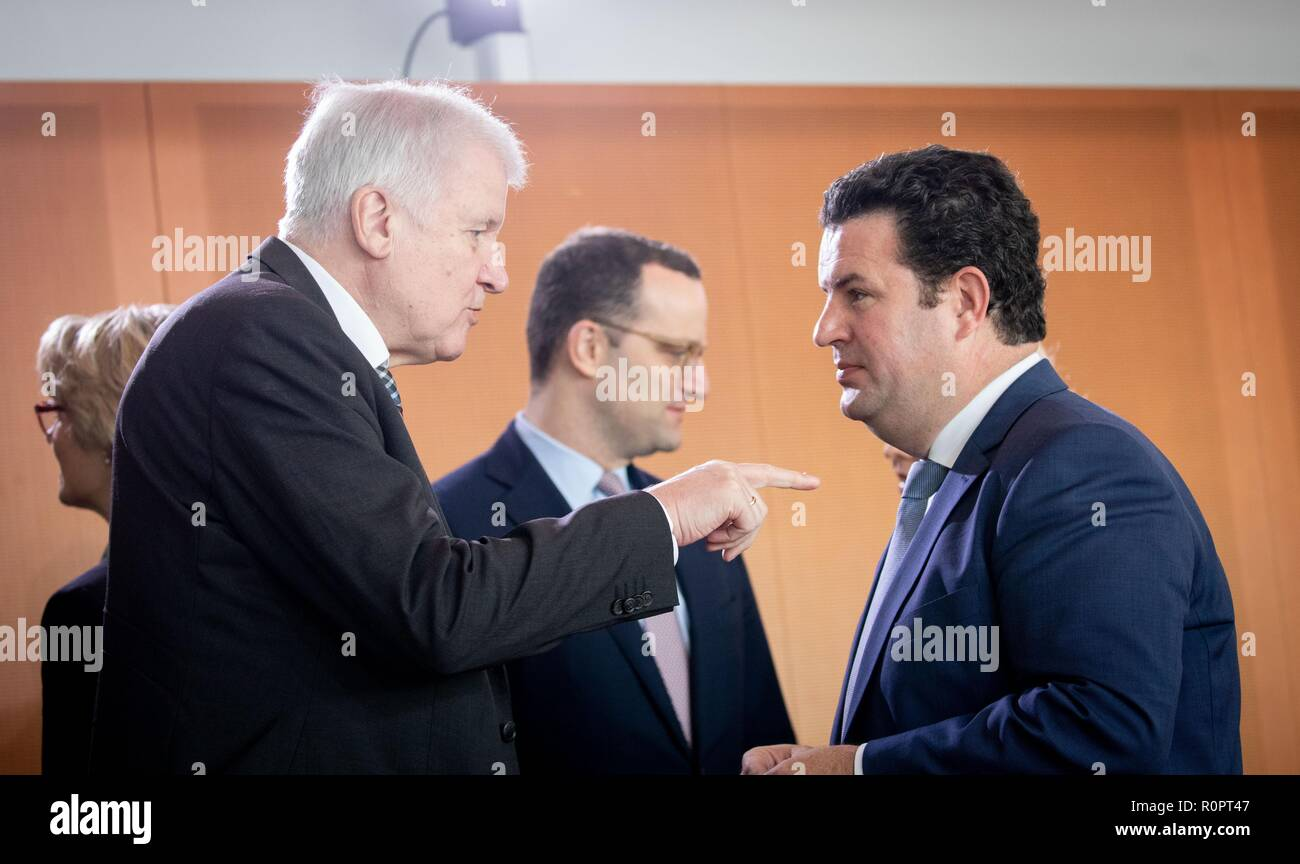 Berlin, Germany. 07th Nov, 2018. Horst Seehofer (l-r, CSU), Federal Minister of the Interior, Building and Home Affairs, Jens Spahn (CDU), Federal Minister of Health, and Hubertus Heil (SPD), Federal Minister of Labour and Social Affairs, attend the Federal Cabinet meeting at the Federal Chancellery. Credit: Kay Nietfeld/dpa/Alamy Live News - Stock Image
