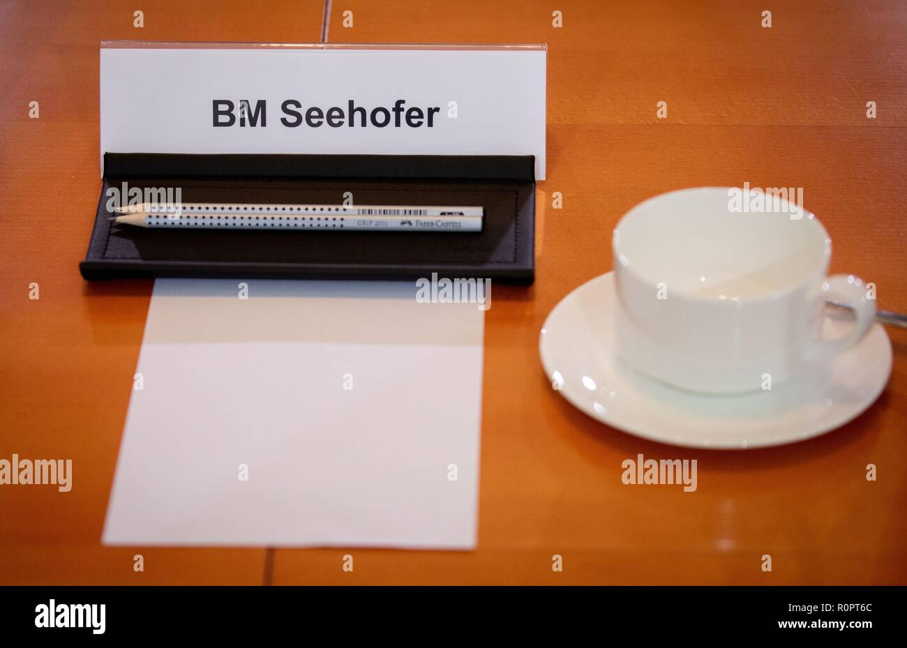 Berlin, Germany. 07th Nov, 2018. The name tag of Horst Seehofer (CSU), Federal Minister of the Interior, for Building and Home, is on the cabinet table at the beginning of the Federal Cabinet meeting in the Federal Chancellery. Credit: Kay Nietfeld/dpa/Alamy Live News - Stock Image