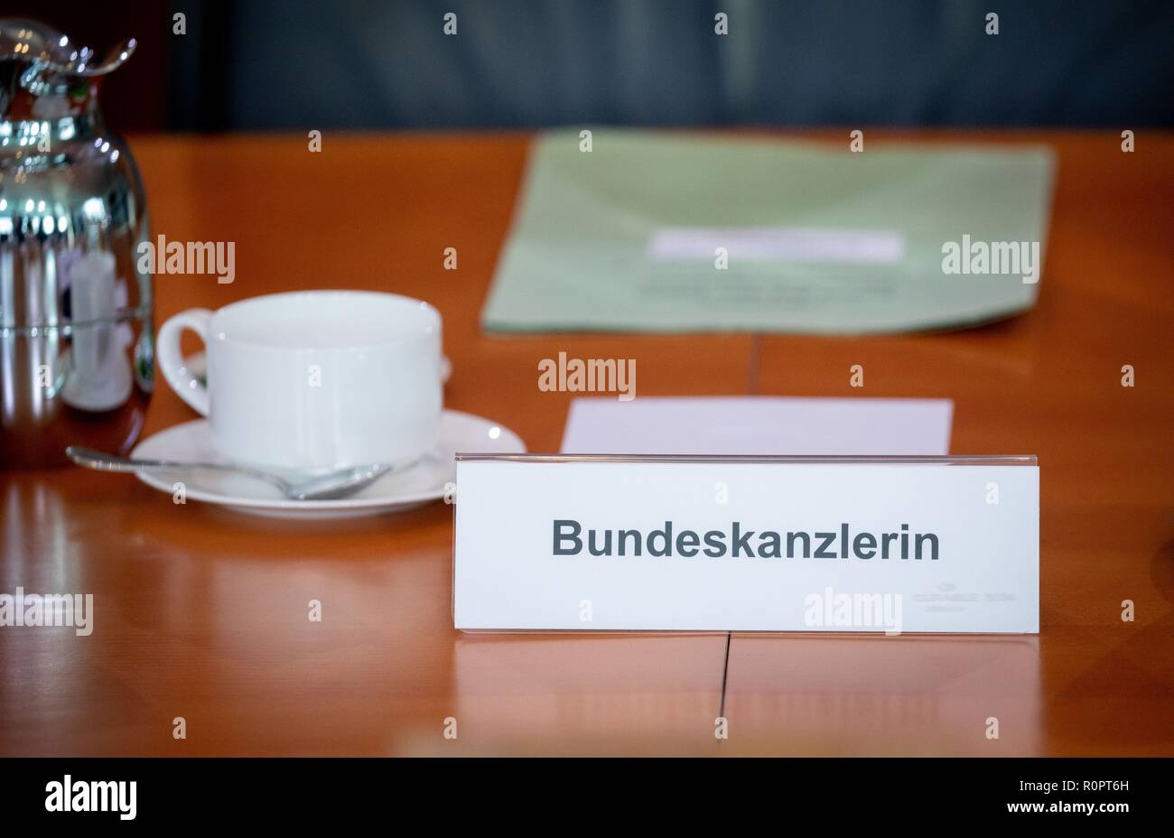 Berlin, Germany. 07th Nov, 2018. The name tag of the Chancellor is on the cabinet table at the beginning of the meeting of the Federal Cabinet in the Federal Chancellery. Credit: Kay Nietfeld/dpa/Alamy Live News - Stock Image