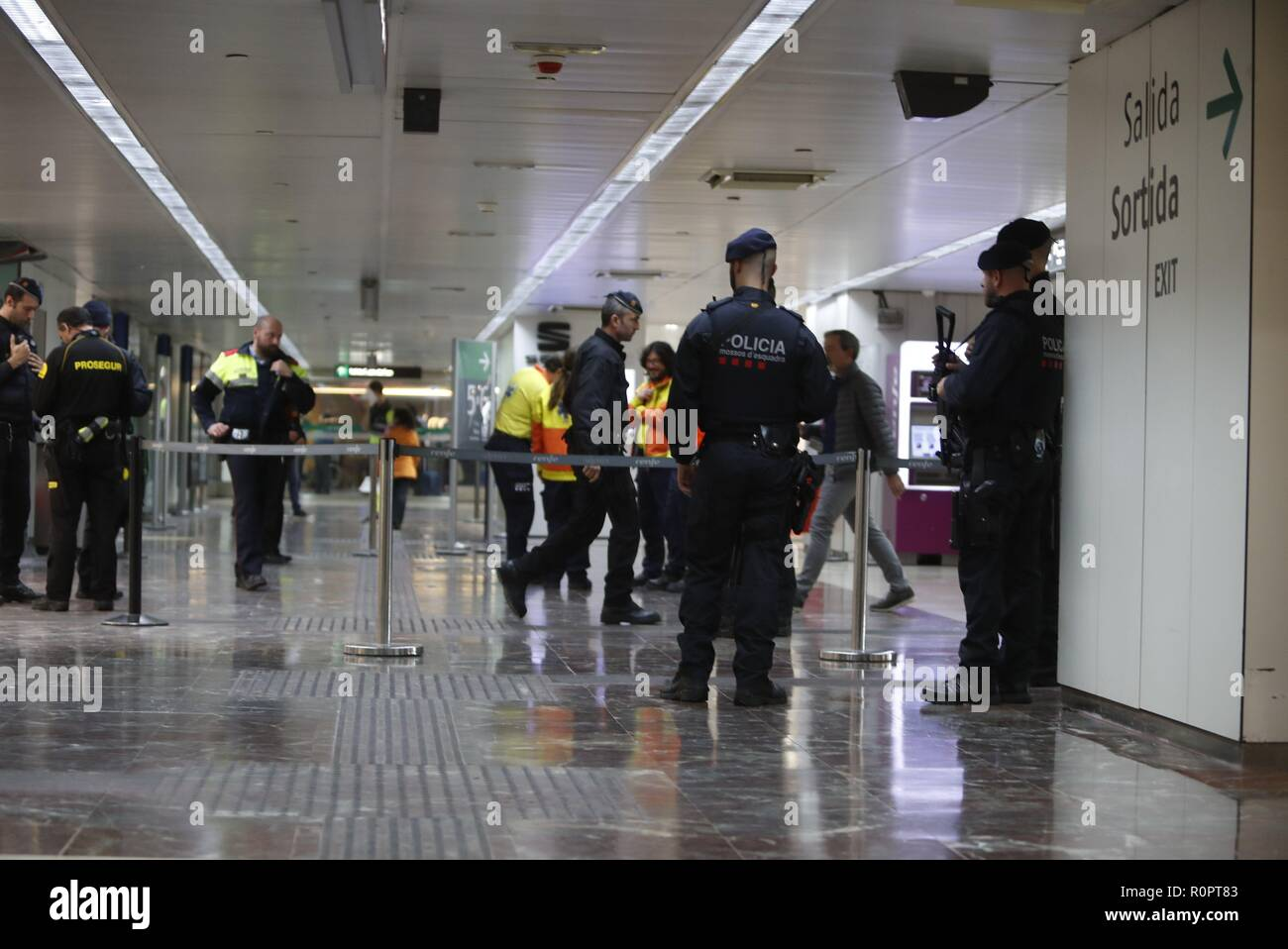 Catalan regional policemen or Mossos d'Esquadra keep watch inside the AVE high speed train station of Sants in Barcelona after two trains had to be evacuated due to a suspicious suitcase, in Barcelona, northeastern Spain, 07 November 2018. National Police has confirmed that the explosive alert issued in the train stations of Sants in Barcelona and Atocha in Madrid is a false alarm. The alert was activated after suspicions about a woman carrying a suitcase with a suspicious object similar to an explosive device inside, get on board an AVE train in Sants heading for Atocha. The train was stopped Stock Photo