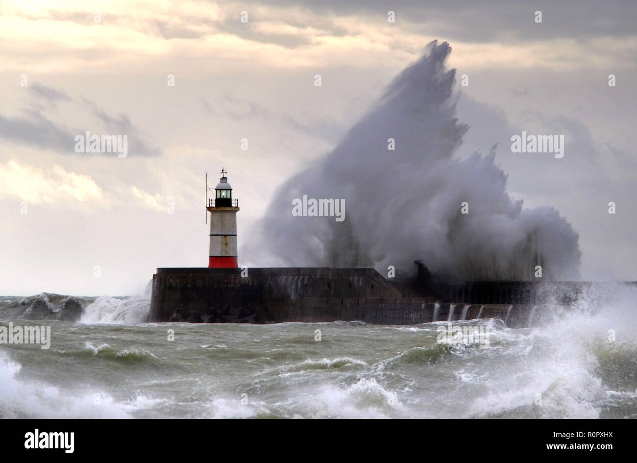 Newhaven, East Sussex, UK. 7th November 2018. Huge waves crash against the sea wall in Newhaven Harbour, East Sussex, as gale force winds batter the south coast. Credit: Peter Cripps/Alamy Live News - Stock Image