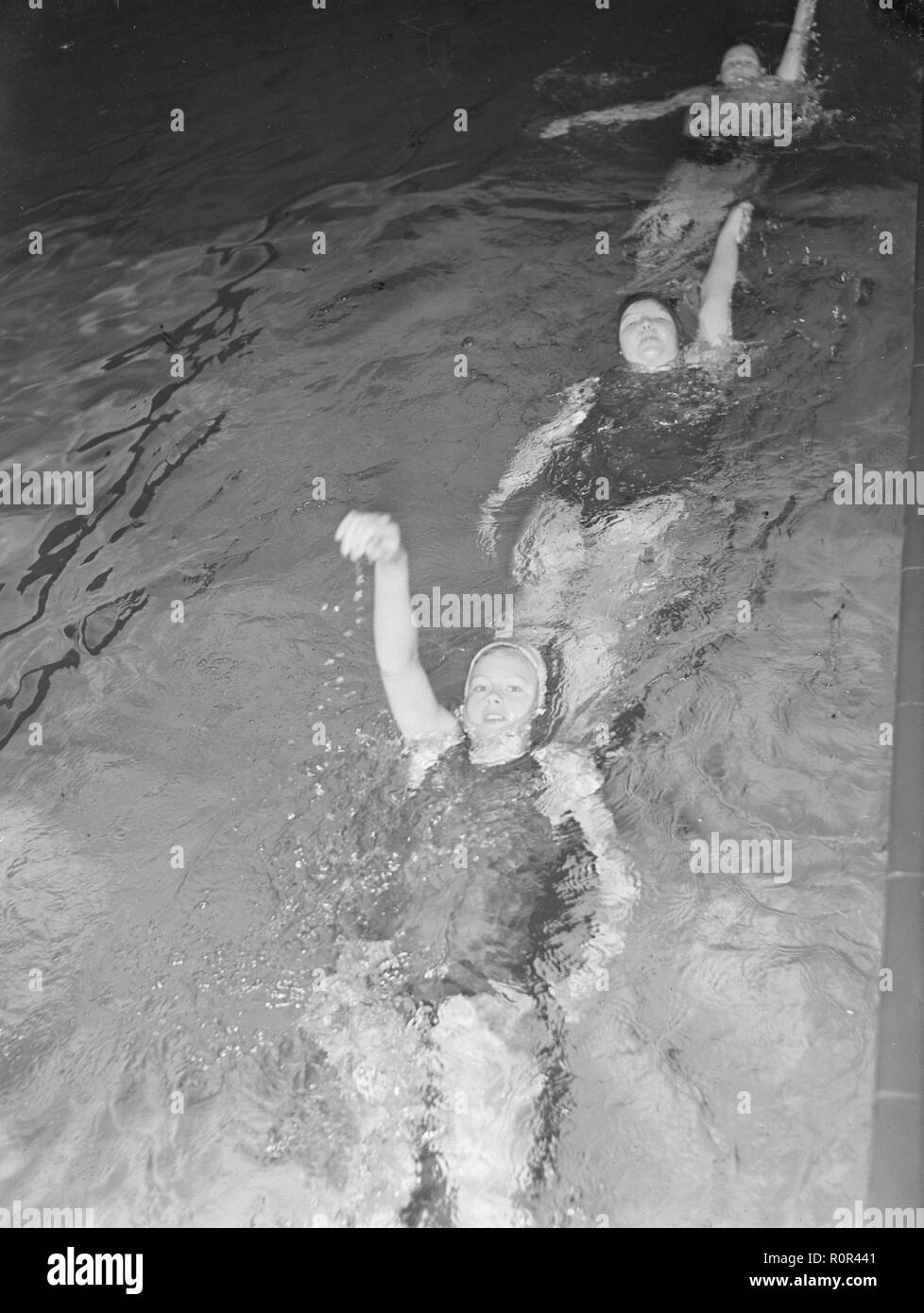 Swimming practice in the 1940s. Three young women are practising backstroke swimming.  March 1940 Sweden Photo Kristoffersson ref 83-2 - Stock Image