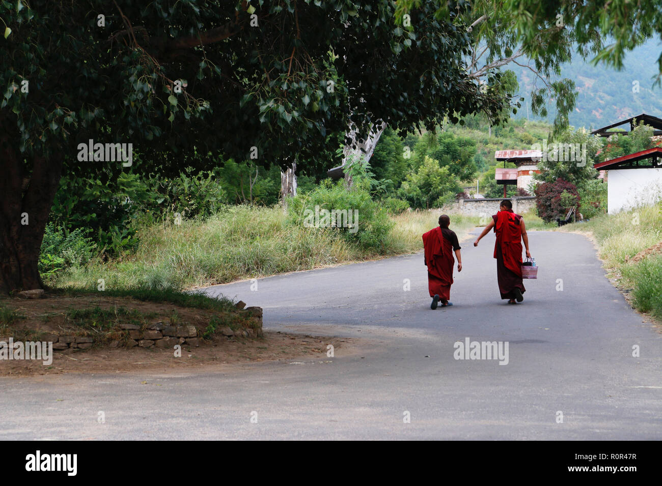 Two young Buddhist monks walking in Punakha, Bhutan - Stock Image