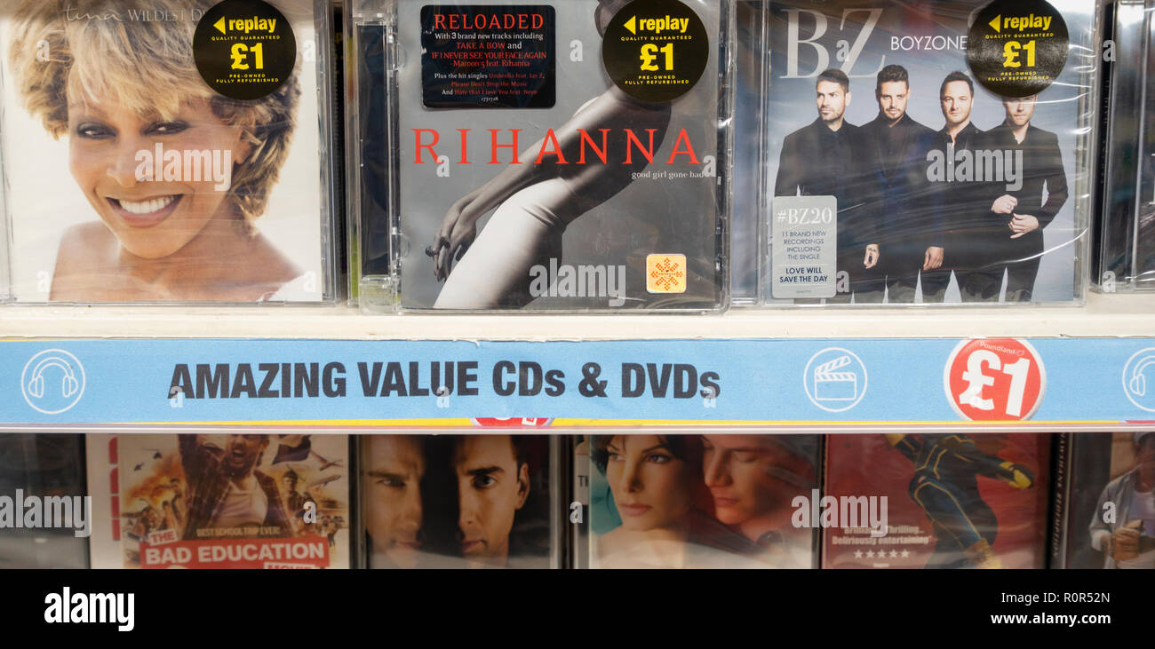 'Refurbished' DVDs and CDs in Poundland store, UK - Stock Image