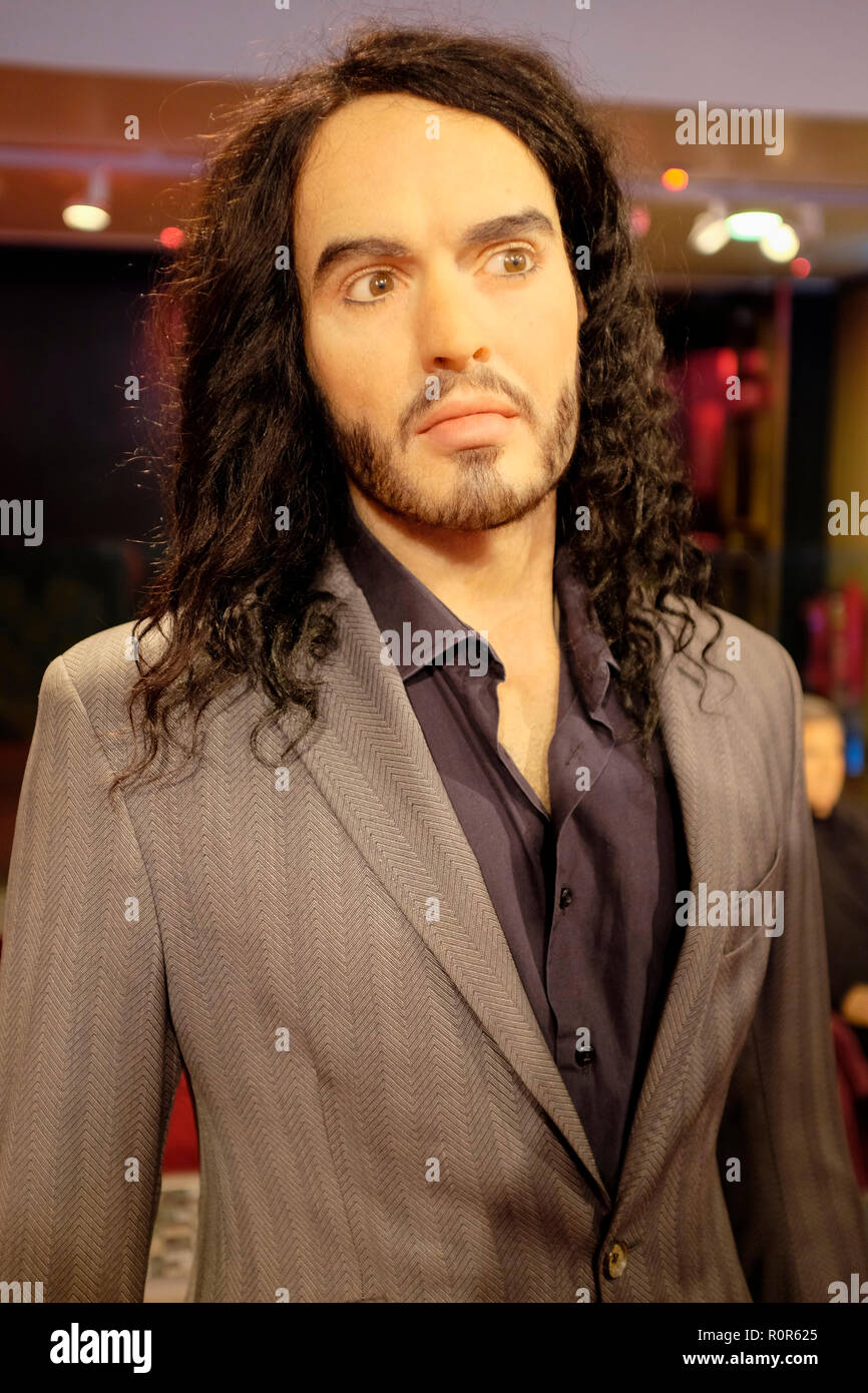 Wax figure of Russell Brand at world renowned tourist attraction Madame Tussauds Wax museum in London, United Kingdom. - Stock Image