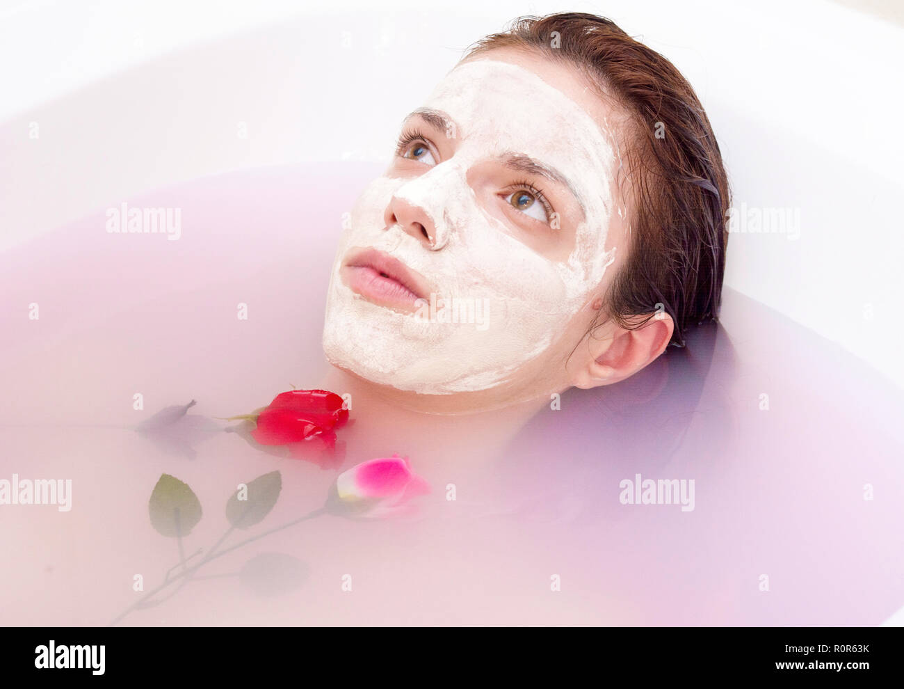 Redhead Model Using A Homemade Face Mask With Rose And Coconut Oil Stock Photo Alamy