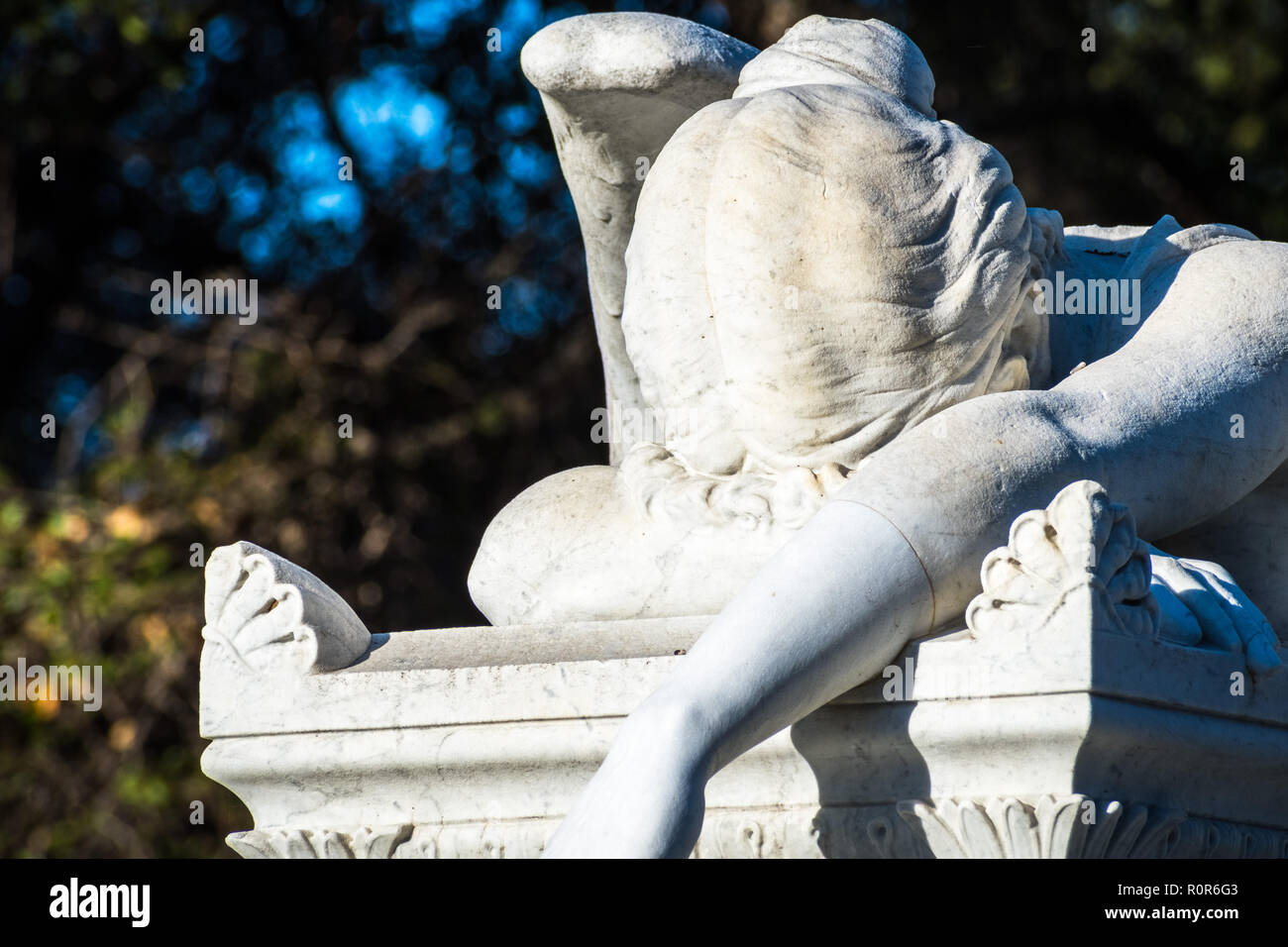 Detail of Weeping angel marble statue located in a public park - Stock Image
