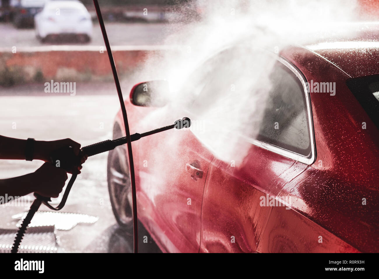 Washing red sport car Stock Photo